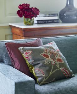 Transitional sofa with embroidered pillows